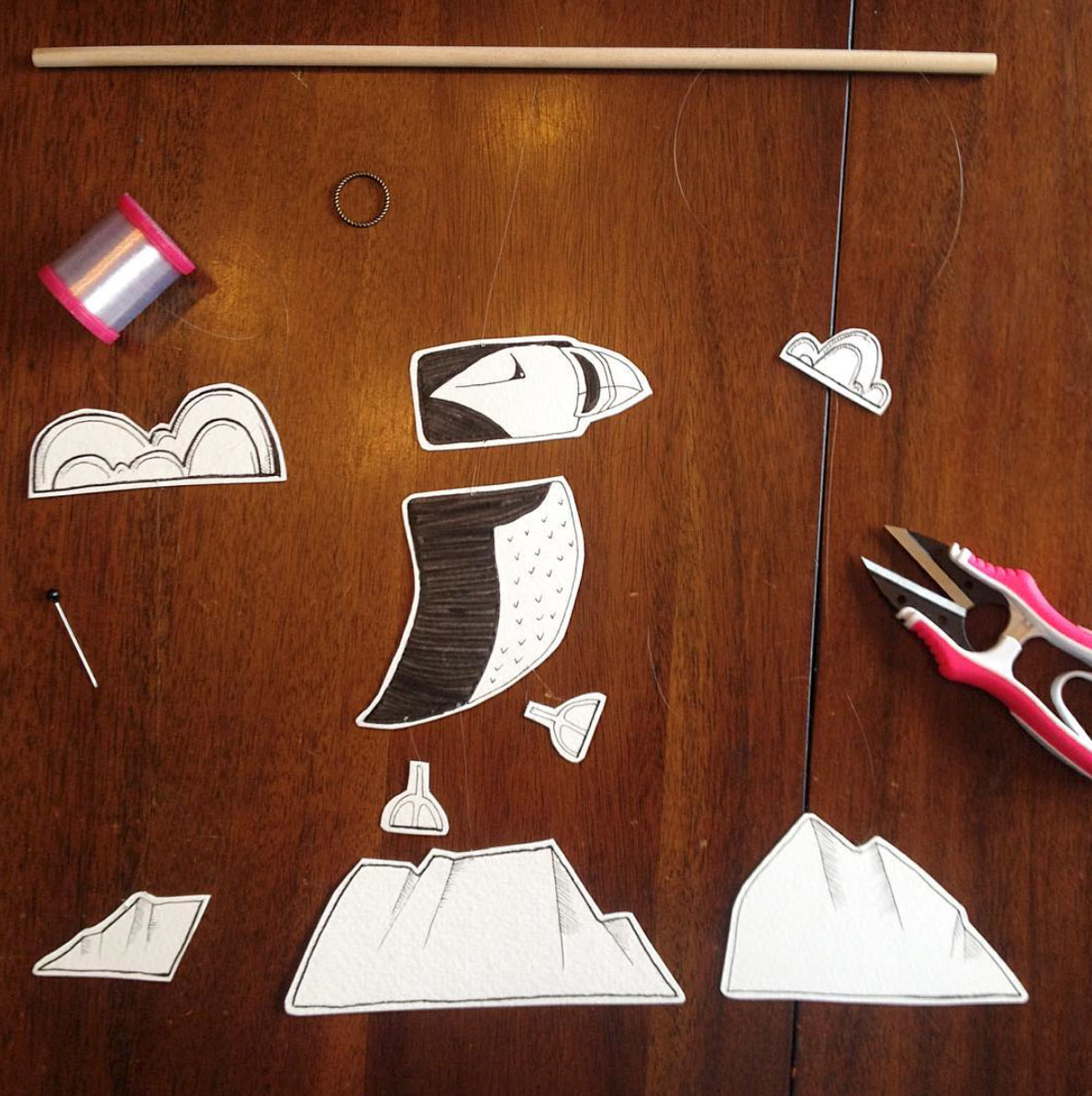 Animal Theme Month of Mobiles - Puffin Paper Mobile in Progress by Annex Suspended