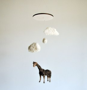 Annex Suspended - giraffe under fluffy clouds