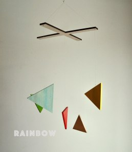 """Happening Mobile """"Rainbow"""" of Blue, Red, Green, Yellow and Raw Wood."""
