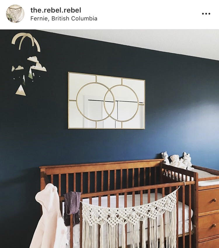 Nursery Room Boho and Mountain inspiration - Fernie, BC. Mountains, rope textile hanger, gold mirror, blue walls.